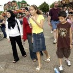 Muslim girls walking at the fair.