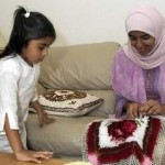 Two Muslim sisters making crafts.