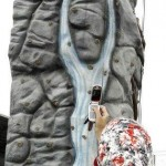 Muslim girl climbing a rock wall