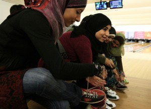 Muslim teenagers bowling at Yerba Buena center in San Francisco